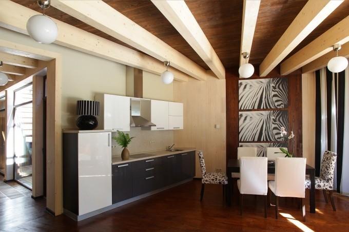 Обыграть балку на потолке: варианты дизайна